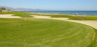 Golf course next to the beach Stock Photo