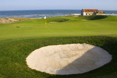 Golf course next to the ocean royalty free stock images