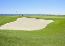 Golf course next to the sea Stock Images