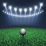Golf course at night. Golf ball on grass and spotlights , Golf tournament Stock Images