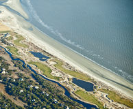 Golf course on the ocean Stock Images