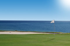 Golf course on the ocean. Royalty Free Stock Photos