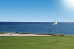 Golf course on the ocean. Royalty Free Stock Photos