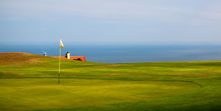 Golf course by the ocean. Stock Photo