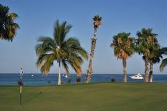 Golf course by the ocean, Cabo Mexico. Golf course of Palmiia bordering the sea of cortez royalty free stock photo