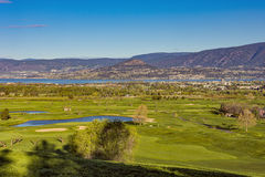 Golf Course Okanagan Valley Kelowna British Columbia. A golf course in the Okanagan Valley with the Kelowna British Columbia Canada skyline and Okanagan Lake in Royalty Free Stock Photos