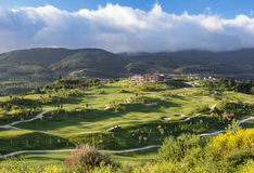 Golf course. Overview in early morning light Royalty Free Stock Photo