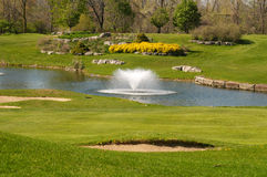 Golf course with a pond stock photo