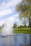 Golf Course Pond And Fountain. As nice a view that this is ... it is a hazard for the golfers. Spring in Wisconsin. The pond is also a used to water the golf Stock Images