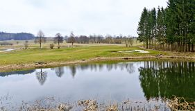 Golf course with pond royalty free stock photo