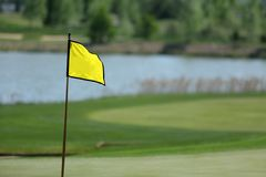 A golf course with roads, bunkers and ponds and with flag royalty free stock photography