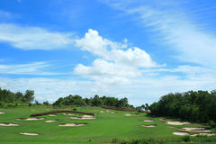 Golf course with sand bunker Stock Photos