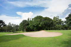 Golf course with sand bunker and green Royalty Free Stock Photos