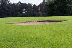 Golf course with sand bunker Royalty Free Stock Photography