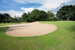 Golf course with sand bunker Royalty Free Stock Image
