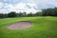 Golf course with sand bunker Stock Images