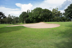 Golf course with sand bunker Stock Photography