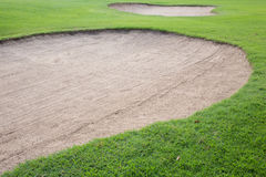 Golf course with sand bunker Royalty Free Stock Photo