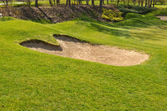 Golf course with a sand trap Royalty Free Stock Photo