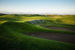 Golf course with sand trap at sunset Royalty Free Stock Photography