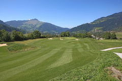 Golf Course Schluein - Sagogn, Switzerland. Golf Course in front of a beautiful landscape scenery Stock Photos