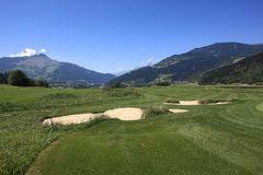 Golf Course Schluein - Sagogn, Switzerland. Golf Course in front of a beautiful landscape scenery Royalty Free Stock Photography