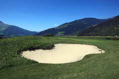 Golf Course Schluein - Sagogn, Switzerland. Golf Course in front of a beautiful landscape scenery Royalty Free Stock Image