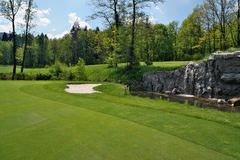 Golf course with small waterfalls Royalty Free Stock Image