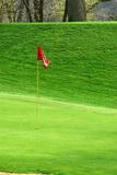 Golf Course In Springtime. A Golf Course In Springtime - The Flag Royalty Free Stock Image