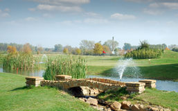 Golf course with stone bridge Stock Images