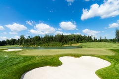 Golf course in the sunlight Royalty Free Stock Photography
