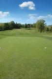 Golf course on a sunny day Stock Photos
