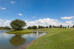Golf Course in Sunny Day Afternoon Stock Image