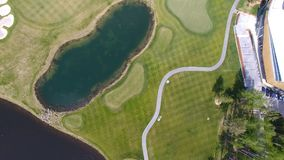 Golf course on a Sunny day, an excellent Golf club with ponds and green grass, view from the sky.  Royalty Free Stock Images