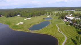 Golf course on a Sunny day, an excellent Golf club with ponds and green grass, view from the sky.  Stock Photos