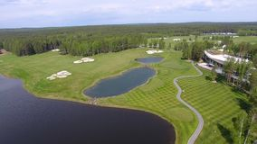 Golf course on a Sunny day, an excellent Golf club with ponds and green grass, view from the sky stock video