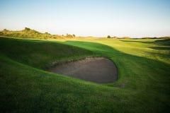 Golf course at sunset Stock Photos
