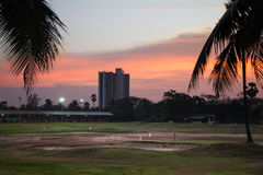 Golf course in sunset time Stock Photos