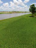 Golf Course under construction. New Golf course with a lake view that is under construction stock image