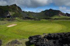Golf course under mountains Royalty Free Stock Photography