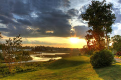 Golf course view. A beautiful river beside the tee-box at a Canadian Golf Course (Nova Scotia) at sunset stock image