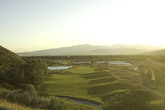 Golf course view from above. With bright sunlight from side Stock Photos