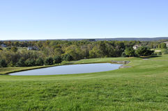 Golf course water hazard Stock Images