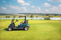 Golf course in west Slovakia and golf car Royalty Free Stock Photo