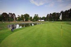 Golf course with white bag ang flag Stock Photos