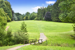 Golf course with wooden bridge Stock Images