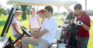 Golf course young people group buggy green field Stock Photos