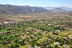 Golf Courses near South Mountain in Phoenix. Golf courses along Baseline Road and the base of South Mountain in Phoenix, Arizona viewed from above Royalty Free Stock Photography