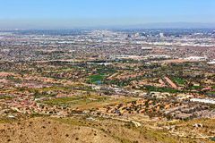 Golf Courses and Phoenix Skyline from above South Mountain. Golf Courses along Baseline Road and downtown Phoenix skyline from above South Mountain Royalty Free Stock Images