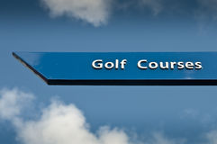 Golf courses sign. Blue sign pointing way to golf courses with sky and clouds in the background Royalty Free Stock Photos